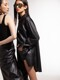 [EXCLUSIVE] H-Line Faux-Leather Wrap Skirt