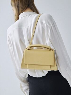 MATIN CLUTCH IN BUTTER CREAM