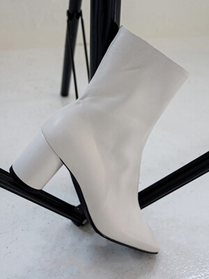 all-white cowhide ankle boots