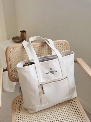 slowstitch white canvas bag