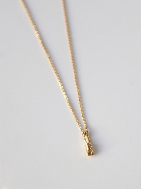 Tiny bone necklace - gold